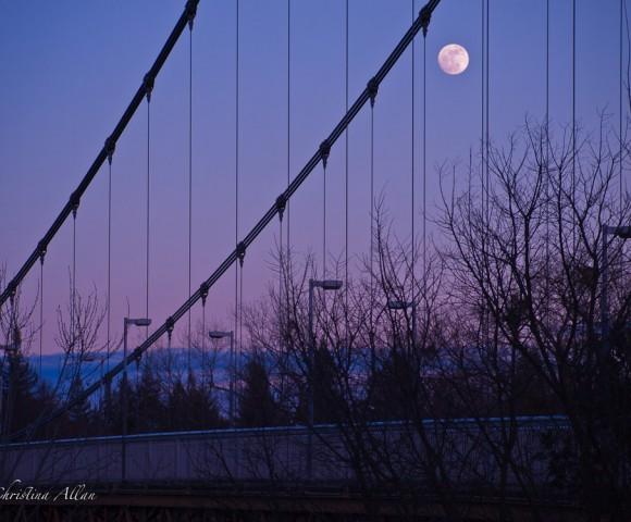 Guy West Pedestrian Bridge at CSUS in Sacramento with Moon