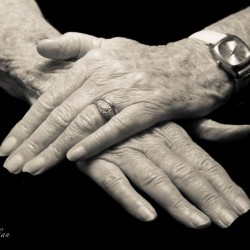 Mother's crossed hands with wedding ring and Parkinson's Disease