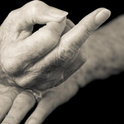 Mother's flipping the bird hands with Parkinson's Disease
