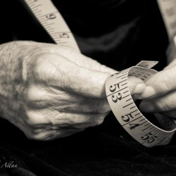 Mother's sewing hands with tape measure and Parkinson's Disease