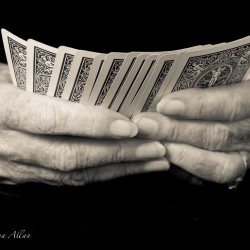 Mother's card player hands with Parkinson's Disease