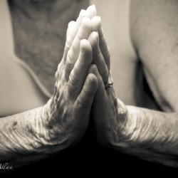 Mother's praying hands with Parkinson's Disease