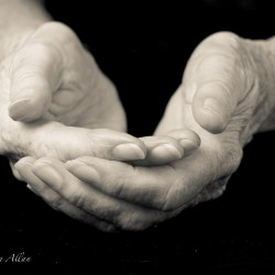 Mother's receiving hands with Parkinson's Disease