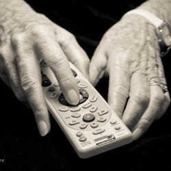 Mother's holding the remote hands with Parkinson's Disease