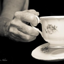 Tea Drinker Mother's teacup hands with Parkinson's Disease