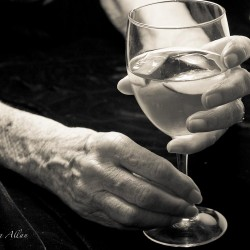 Mother's happy hour with wine glass hands with Parkinson's Disease