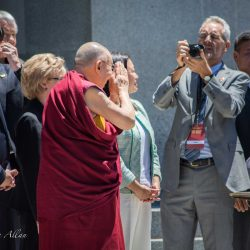 Bowing at camera capitol sacramento dalai lama visit allan