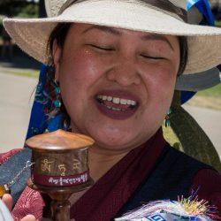 Explaining prayer wheel bystander sacramento capitol dalai lama visit allan