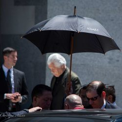 Getting out of car capitol umbrella sacramento dalai lama visit allan