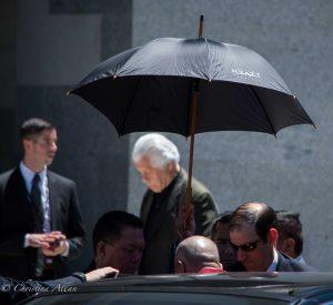 Getting out of car capitol umbrella sacramento dalai lama visit allan
