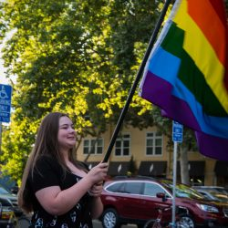 Girl with rainbow flag orlando vigil sacramento allan