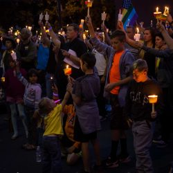 Kids crowd raising candles orlando vigil sacramento allan