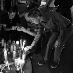Putting Candle at Orlando Memorial Sacramento Allan black and white