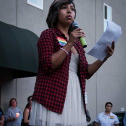 Red checked shirt speaker orlando vigil sacramento allan