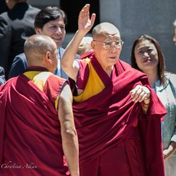 Waving at crowd capitol sacramento dalai lama visit allan