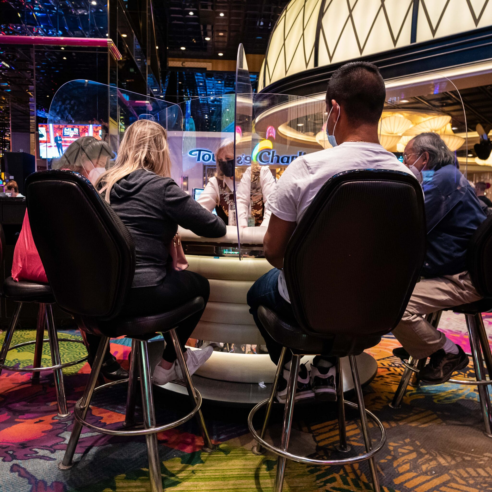 reno in transition, gambling, casino, masked, chair, dealer, cards, chris allan, covid transition time for Reno