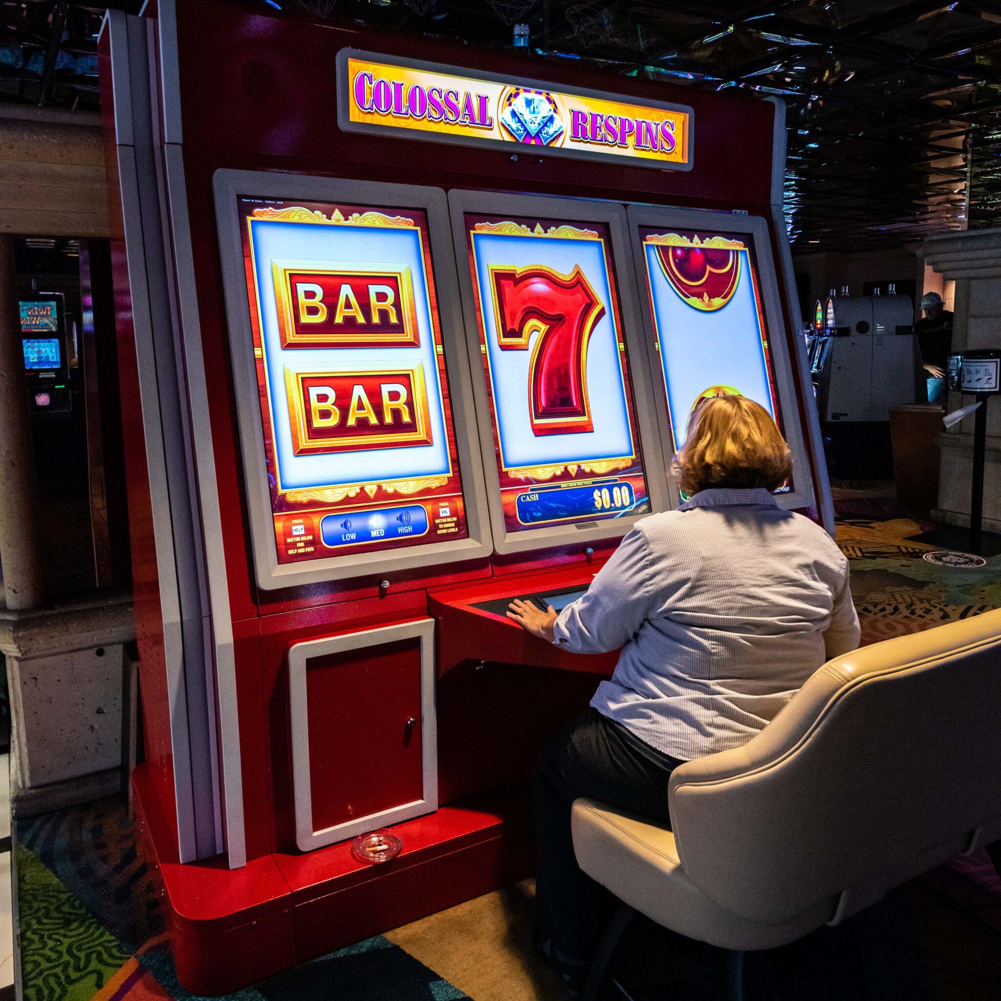 woman, slot machine, gigantic, funny, red, reno in transition, atlantis casino, chris allan, covid transition time for Reno