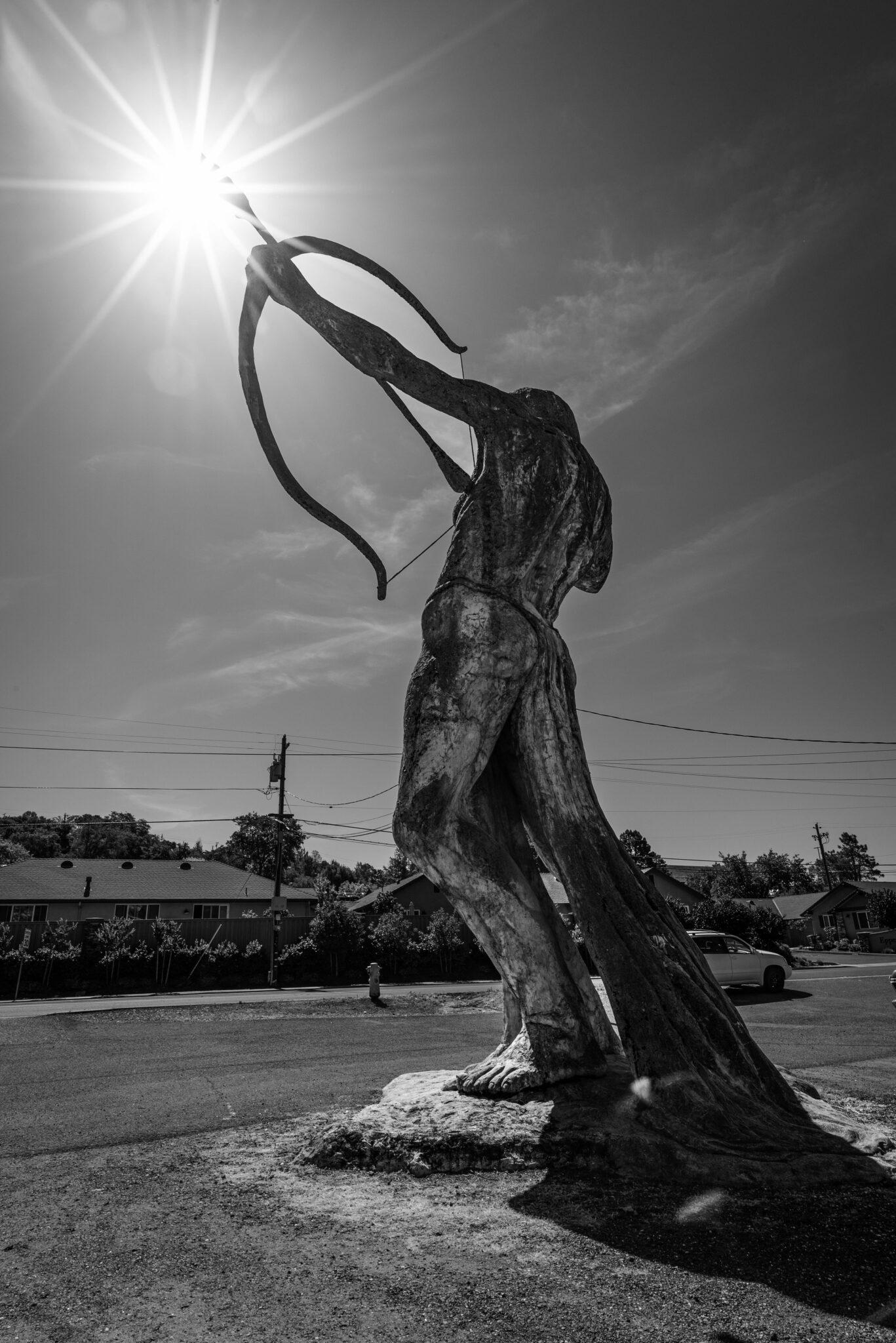 black and white photo ken fox statues amazon woman archer auburn california chris allan sunburst public art