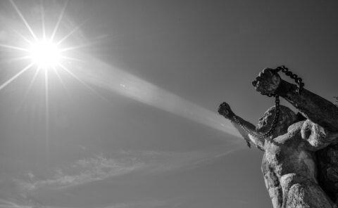 black and white photo ken fox statues man in chains auburn california chris allan sunburst public art