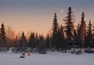 Snowmobilers with Moon