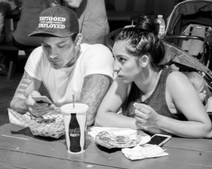 Tattooed-and-employed-cap-couple-with-food