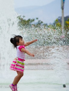 Child Playing in Fountain
