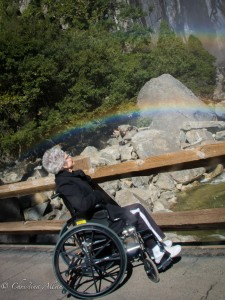 Mom doing wheelie under rainbow