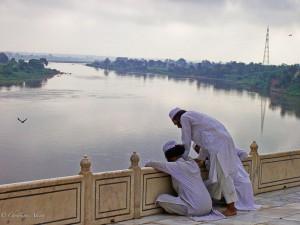 Muslim Men Overlooking Yamuna River