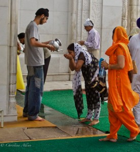 Woman Drinking Water at Delhi Sikh Temple