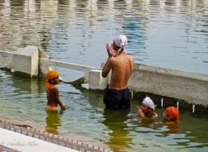 Man with Children at Delhi's Sikh Temple