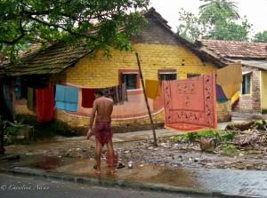 Man Brushing Teeth in Calcutta