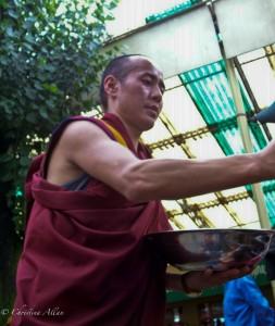 Tibetan Buddhist Monk Serving Tea at Dalai Lama's Birthday Event