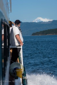 Boat passenger looking at Mount Baker