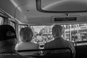 B&W Older couple on bus Oxford Street London Allan