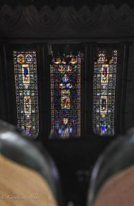 Stained glass window reflection baptismal font salisbury cathedral