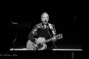 Black and white playing acoustic guitar Neil Diamond Concert 50th Anniversary Tour Sacramento Allan