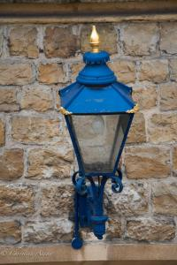 Blue lamp on wall tower of london allan