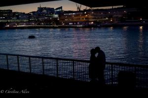 Couple kissing night london thames allan