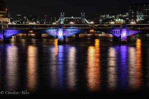 Southwark and Tower Bridges with train lights night allan