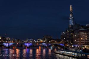 Thames riverboat with shard building and london bridge
