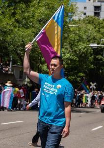 Asian PGE man with transgender flag gay pride parade lgbtq sacramento california allan DSC 0209