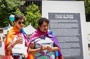 Black and trans bisexual lives matter two young men with flag capes gay pride festival sacramento 6102018 allan DSC 0262 (2)