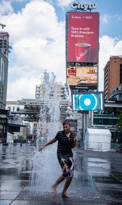 Boy water fountain yonge dundas square toronto ontario canada 72518 allan DSC 1594-2