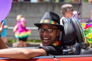 Close up man in rainbow fedora driving gay pride parade lgbtq sacramento california allan