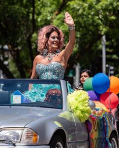 Dome Moore Drag Queen waving car gay pride parade lgbtq sacramento california