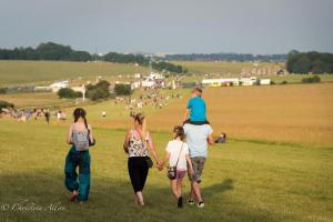 Family walking to stonehenge summer solstice  england allan