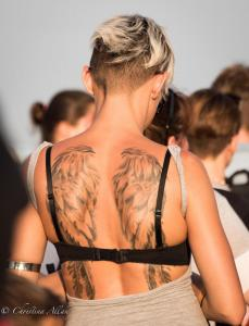 Girl with wings tattoo on back stonehenge summer solstice  england allan