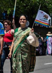 Indian woman sari rainbow california flag gay pride parade lgbtq sacramento california allan