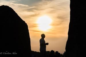 Man facing stones silhouette stonehenge summer solstice  england allan