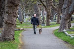 Man walking dog ross bay cemetary victoria b.c. canada allan 1008